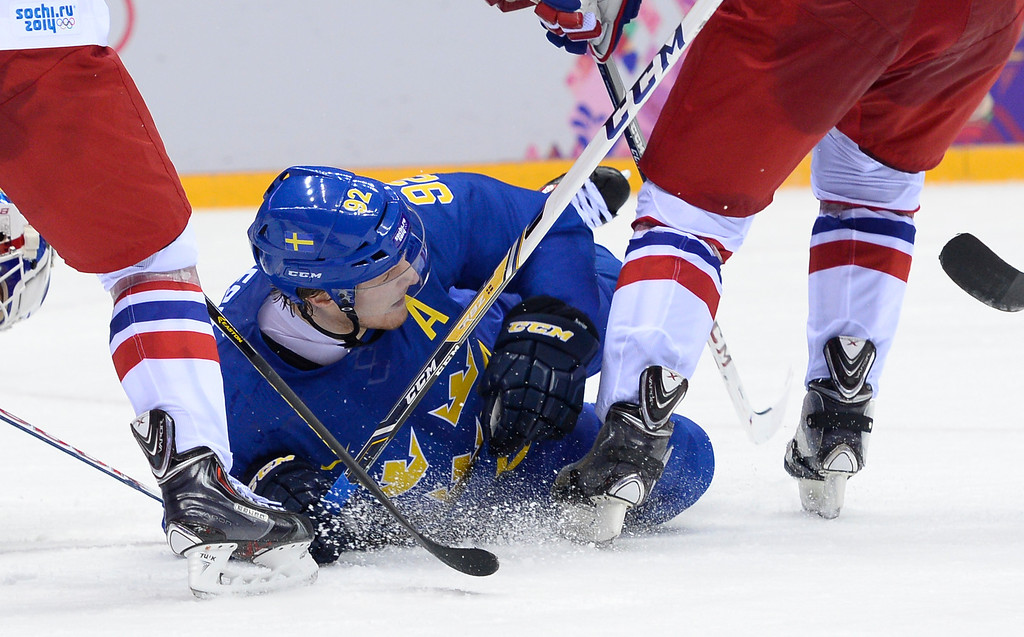 . Sweden\'s Gabriel Landeskog falls during the Men\'s Ice Hockey Group C match Czech Republic vs Sweden at the Bolshoy Arena during the Sochi Winter Olympics on February 12, 2014.   JONATHAN NACKSTRAND/AFP/Getty Images