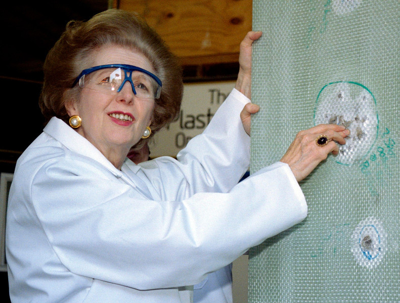 """. Baroness Thatcher examines a sheet of bullet-proof material during a visit to a factory producing ballistic and blast protection products in this April 9, 1997 file photo. Margaret Thatcher, the \""""Iron Lady\"""" who dominated British politics for two decades, died on April 8, 2013 following a stroke, a spokesman for her family said. She was 87.  REUTERS/Michael Crabtree/Files"""