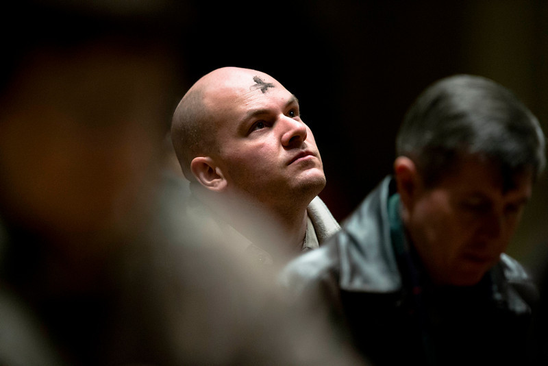 . A man looks skyward as he participates in an Ash Wednesday Mass at the Cathedral Basilica of Saints Peter and Paul in Philadelphia Wednesday, March 5, 2014, in Philadelphia. Ash Wednesday marks the beginning of Lent, a time when Christians prepare for Easter through acts of penitence and prayer. (AP Photo/Matt Rourke)