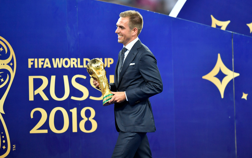 . Germany\'s Philipp Lahm, captain of the Germany\'s 2014 world Cup winning team, brings the trophy after the final match between France and Croatia at the 2018 soccer World Cup in the Luzhniki Stadium in Moscow, Russia, Sunday, July 15, 2018. (AP Photo/Martin Meissner)