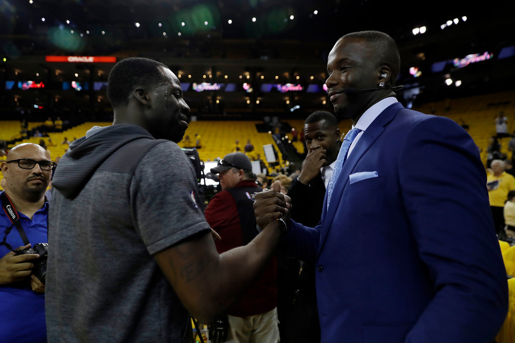 . Golden State Warriors\' Draymond Green, left, shakes hands with former player Jermaine O\'Neal before Game 1 of basketball\'s NBA Finals against the Cleveland Cavaliers Thursday, June 1, 2017, in Oakland, Calif. (AP Photo/Marcio Jose Sanchez)