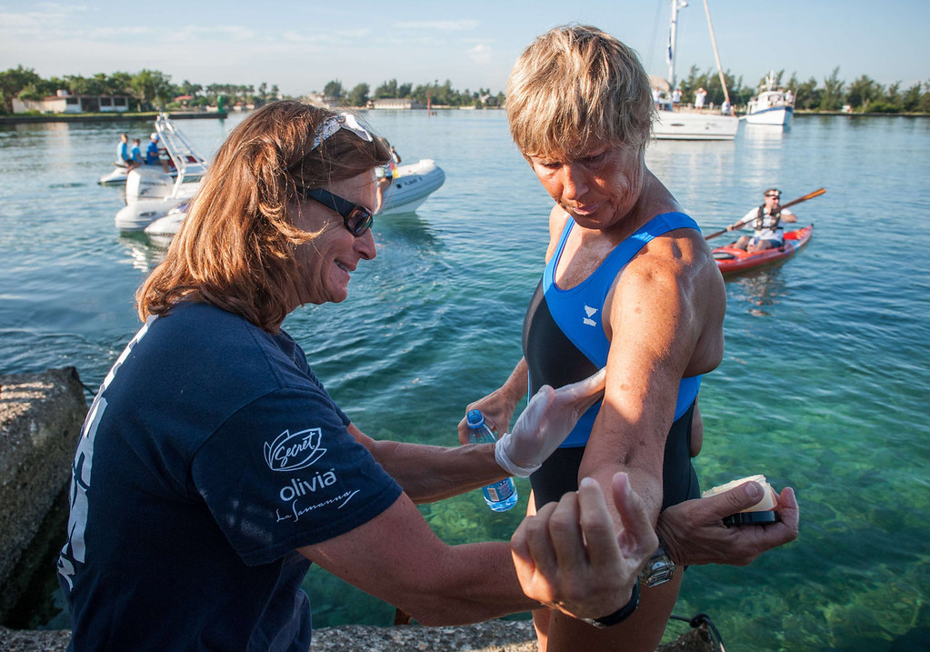 . US swimmer Diana Nyad (R) gets ready to swim in a three-day non-stop journey from Havana to Florida at the Ernest Hemingway Nautical Club, in Havana on August 31, 2013.   YAMIL LAGE/AFP/Getty Images