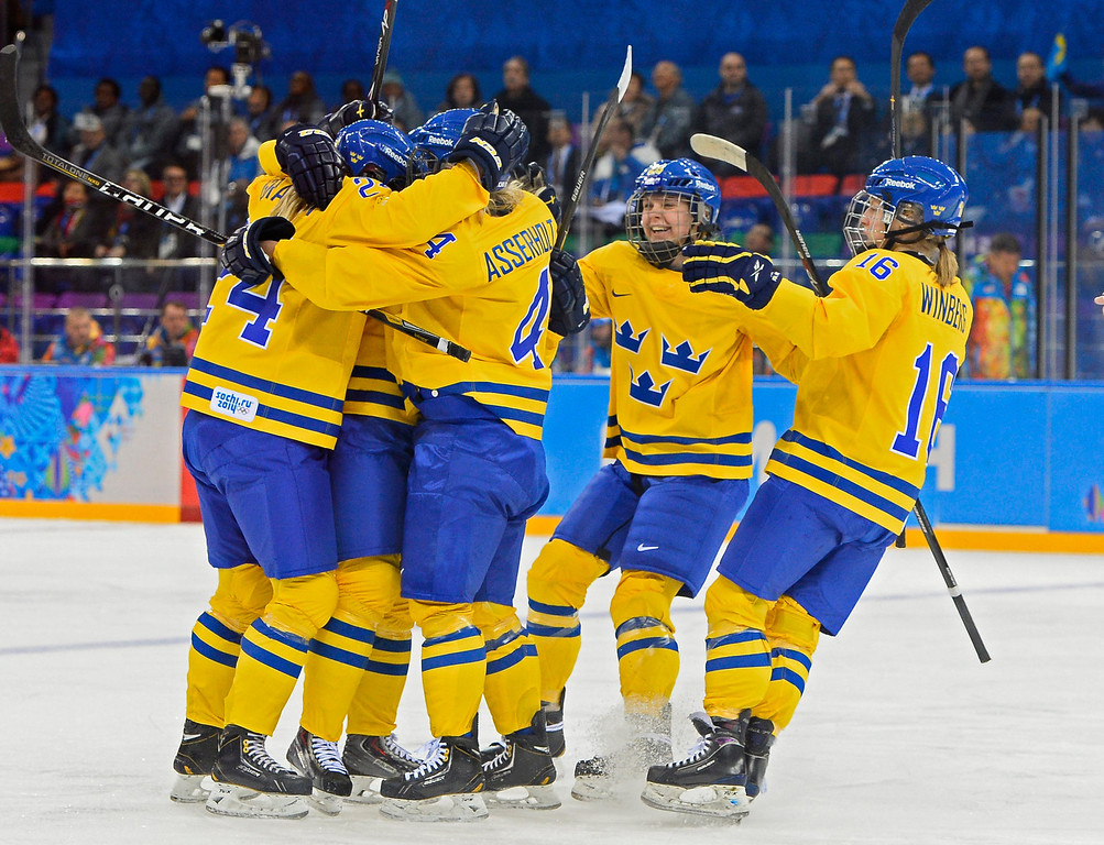 . Sweden players celebrate a goal by teammate Jenni Asserholt against Japan in the first period in the first period during the match between Sweden and Japan at the Shayba Arena in the Ice Hockey tournament at the Sochi 2014 Olympic Games, Sochi, Russia, 09 February 2014  EPA/LARRY W. SMITH