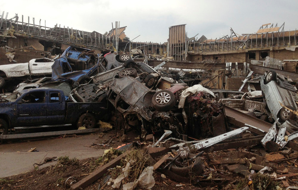 . Overturned cars are seen after a huge tornado touched down in the town of Moore, near Oklahoma City, Oklahoma May 20, 2013.  The huge tornado that struck the town of Moore, Oklahoma, on Monday was given a preliminary rating of at least EF4, or the second highest strength level, with winds of up to 200 miles per hour (321 kph), a U.S. government agency said.   REUTERS/Richard Rowe