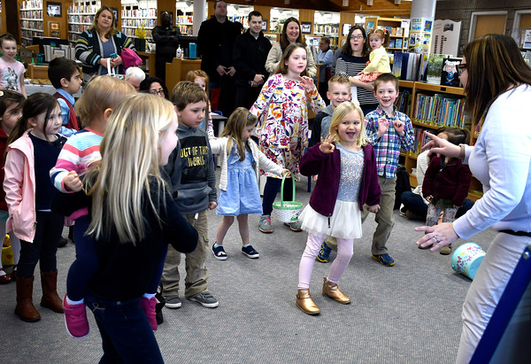 3/31/2018 Mike Orazzi | Staff Children dance and sing before the start of the Manross Library Easter Egg hunt on Saturday in Bristol.