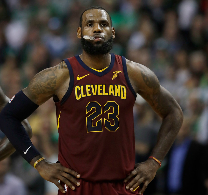 . Cleveland Cavaliers forward LeBron James stands on the court during a timeout in the second half in Game 2 of the team\'s NBA basketball Eastern Conference finals against the Boston Celtics, Tuesday, May 15, 2018, in Boston. (AP Photo/Charles Krupa)