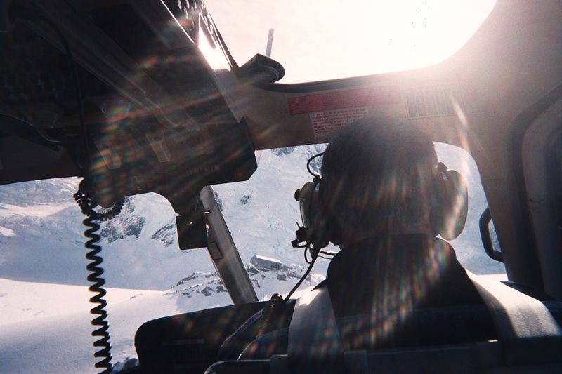 Helo pilot coming into land at Plateau Hut. Taken during our airlift after the accident. 30 Mar 04