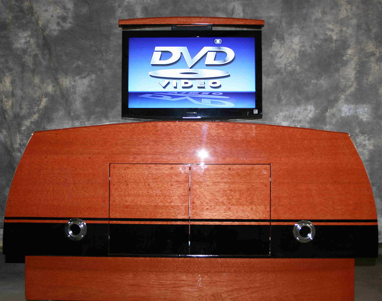 Entertainment center with a 32 inch flat scren tv remotely operated.