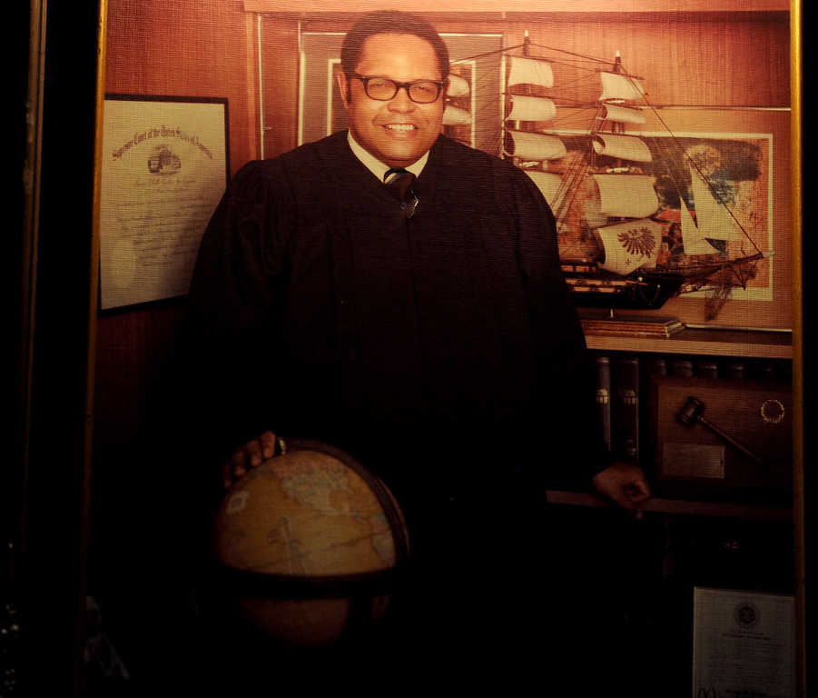 . A photo of a younger Superior Court Judge Marcus Tucker, who was the first African-American judge to be appointed to the Municipal Court of Long Beach, hangs at his home. He heard the Rev. Martin Luther King Jr. several times speak and said he was inspired by him. (Photo by Sean Hiller/ Press Telegram/ LANG) 08-20-2013