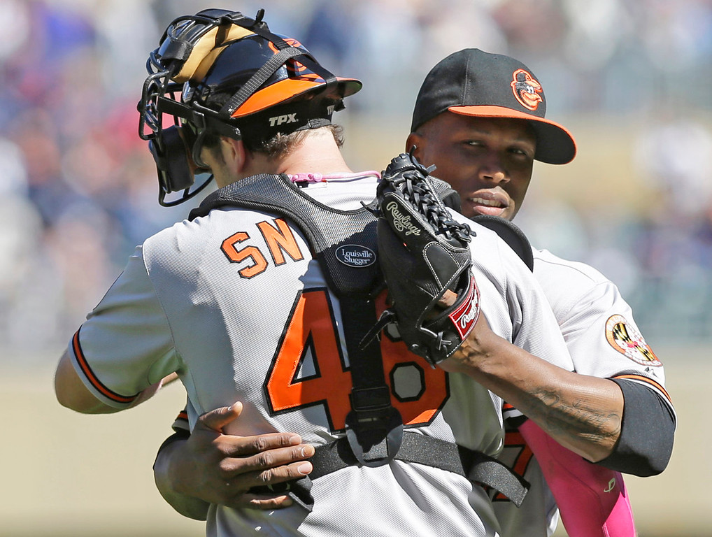 . Orioles pitcher Pedro Strop, right, hugs catcher Chris Snyder after throwing a scoreless ninth inning in Minnesota\'s 6-0 loss to Baltimore at Target Field in Minneapolis on Sunday, May 12, 2013. (AP Photo/Jim Mone)