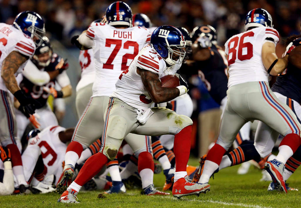 . Running back Brandon Jacobs #34 of the New York Giants runs the ball against the Chicago Bears in the first quarter during a game at Soldier Field on October 10, 2013 in Chicago, Illinois.  (Photo by Jonathan Daniel/Getty Images)