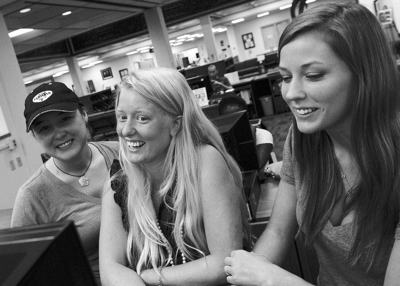 Students Mel Hammond, Sabrina Downey and Sarah White finish up their group presentation in the library.