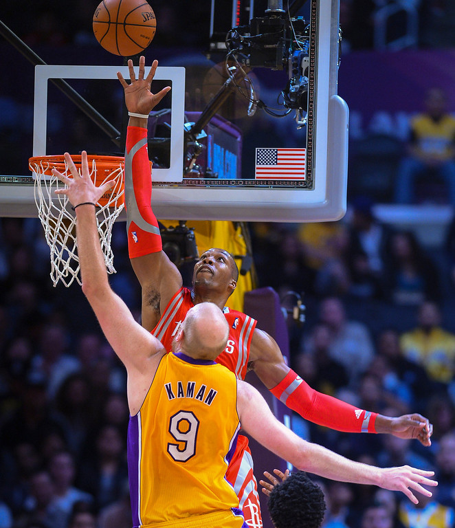 . Rockets� Dwight Howard blocks a shot by Lakers� Chris Kaman during first half action at Staples Center Wednesday, February 19, 2014. ( Photo by David Crane/Los Angeles Daily News )