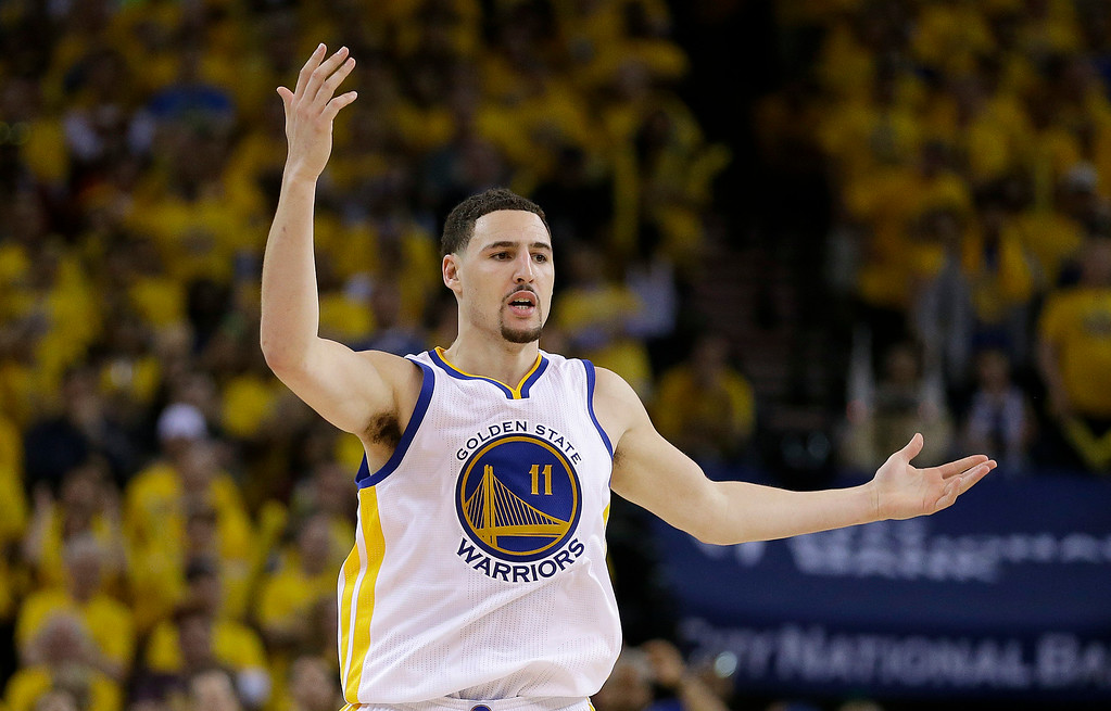 . Golden State Warriors guard Klay Thompson (11) reacts during the second half of Game 1 of basketball\'s NBA Finals against the Cleveland Cavaliers in Oakland, Calif., Thursday, June 4, 2015. (AP Photo/Ben Margot)