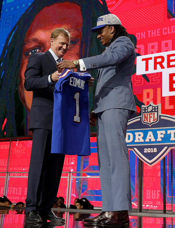 . Commissioner Roger Goodell, left, presents Virginia Tech\'s Tremaine Edmunds with Buffalo Bills jersey during the first round of the NFL football draft, Thursday, April 26, 2018, in Arlington, Texas. (AP Photo/David J. Phillip)