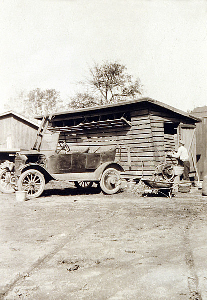 Grandpa R. Shelling Corn with the Car check the Wheel out.JPG