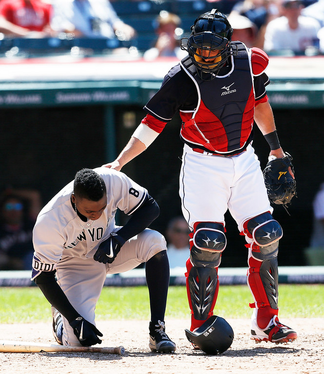 . New York Yankees\' Didi Gregorius (18) gets up after being hit by a pitch from Cleveland Indians relief pitcher TJ House as catcher Yan Gomes looks on during the fifth inning of a baseball game Sunday, July 10, 2016, in Cleveland. The Yankees won 11-7. (AP Photo/Ron Schwane)