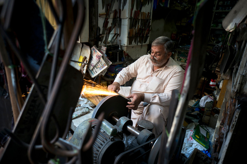 . A Pakistani vendor sharpens knives for customers for the upcoming Muslim holiday of Eid al-Adha, in Rawalpindi, Pakistan, Monday, Sept.12, 2016. Pakistanis will celebrate the Eid al-Adha, or the Feast of the Sacrifice, on Tuesday to mark the willingness of the Prophet Ibrahim -- Abraham to Christians and Jews -- to sacrifice his son. During the holiday Muslims slaughter sheep and cattle, distribute part of the meat to the poor and eat the rest. (AP Photo/B.K. Bangash)