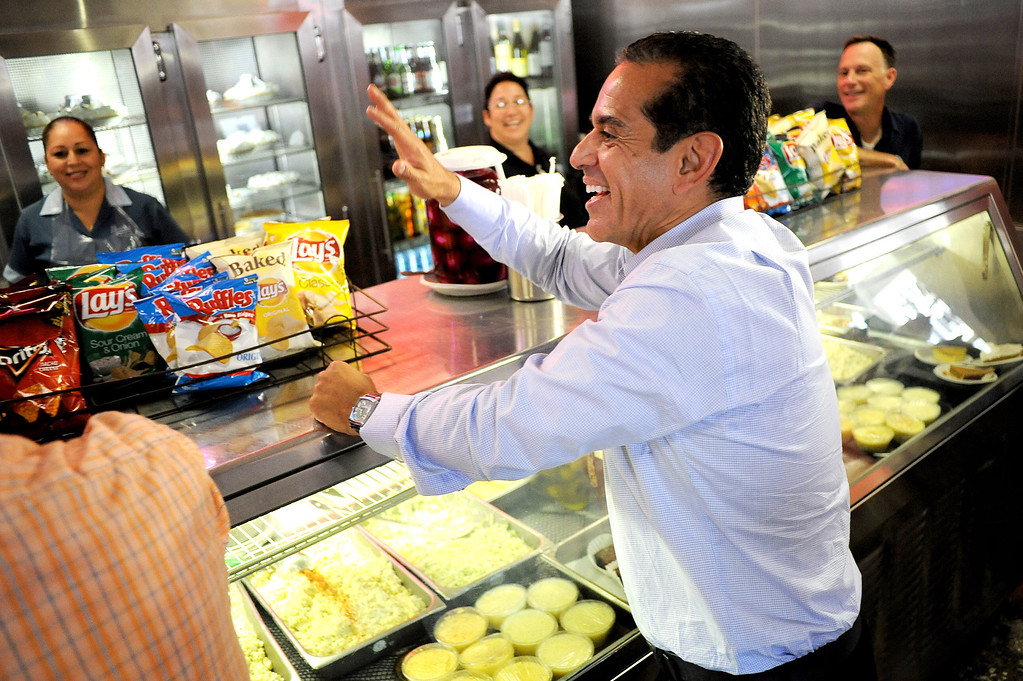 . Mayor Antonio Villaraigosa waves to workers at Philippe\'s in Los Angeles, CA June 28, 2013.  Villaraigosa spent the day visiting some of his favorite loactions during his 24-hour goodbye tour.(Andy Holzman/Los Angeles Daily News)
