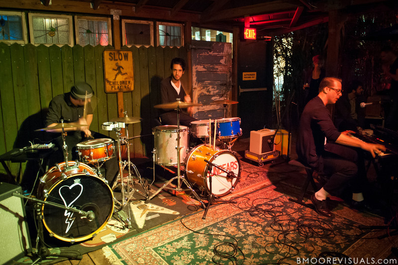 Dean Lorenz, Jared Bowser (of Sunbears!), and Eric Collins of MRENC perform on November 24, 2010 at New World Brewery in Ybor City, Tampa, Florida