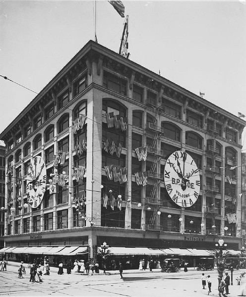 Bullocks store decorated with flags and a big clock welcoming the Shriner's to L.A., ca.1918
