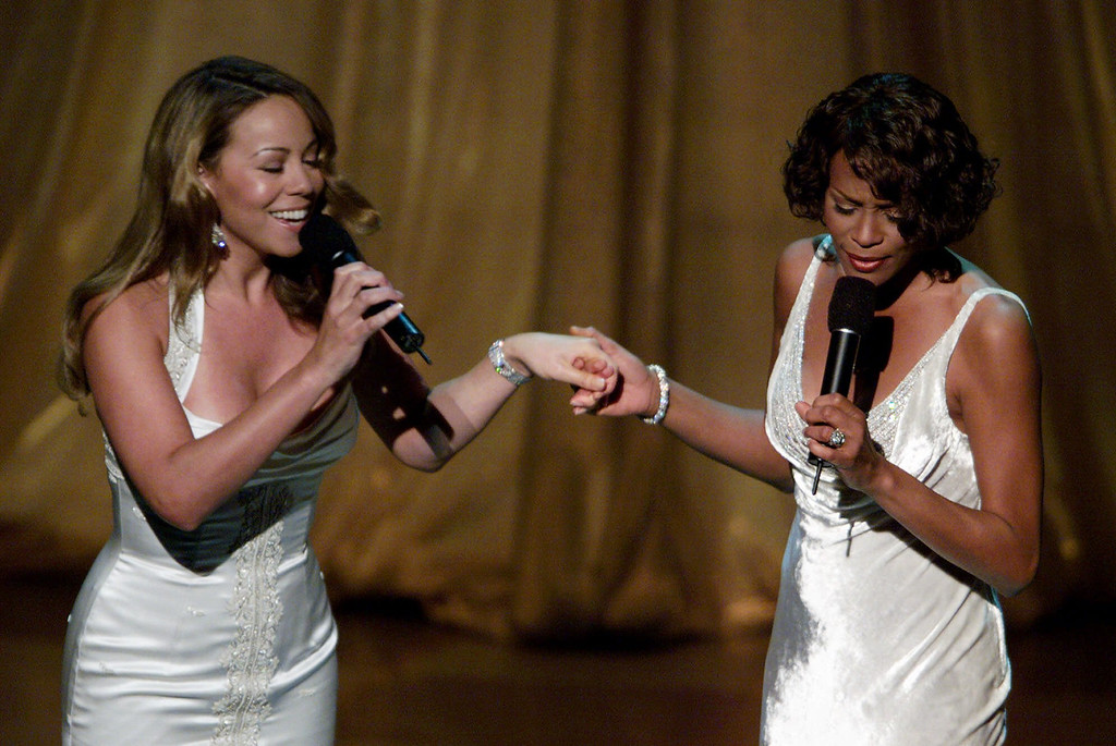 ". Mariah Carey, left, and Whitney Houston perform their Oscar-nominated song, ""When You Believe\"" from the movie \""The Prince of Egypt,\"" during the 71st Annual Academy Awards at the Dorothy Chandler Pavilion of the Los Angeles Music Center Sunday, March 21, 1999. (AP Photo/Eric Draper)"