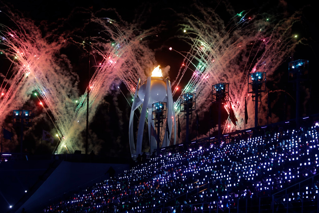 . Fireworks explode over the Olympic flame during the closing ceremony of the 2018 Winter Olympics in Pyeongchang, South Korea, Sunday, Feb. 25, 2018. (AP Photo/Michael Probst)