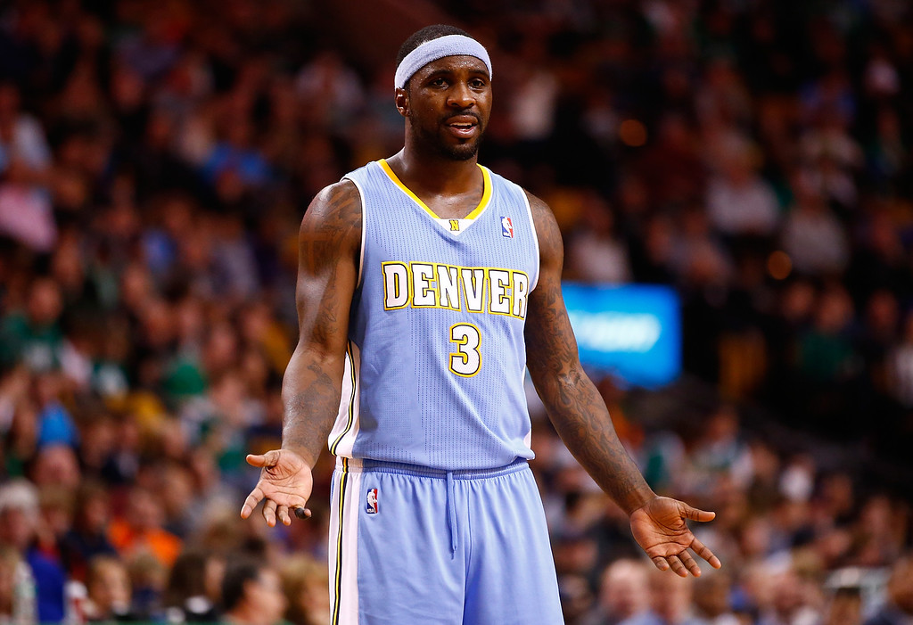 . BOSTON, MA - DECEMBER 06: Ty Lawson #3 of the Denver Nuggets reacts following a foul call in the second quarter against the Boston Celtics during the game at TD Garden on December 6, 2013 in Boston, Massachusetts.  (Photo by Jared Wickerham/Getty Images)