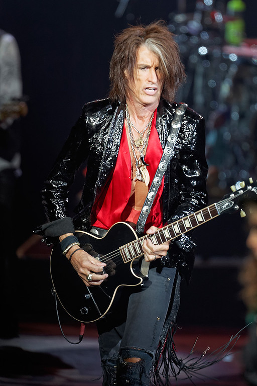 . Joe Perry of Aerosmith performs on Tuesday, Sept. 9, 2014, at DTE Energy Music Theatre in Independence Township. Photo by Ken Settle