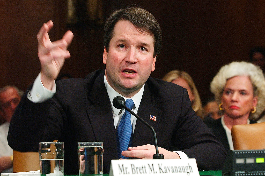 . FILE -In this April 26, 2004, file photo,  Brett Kavanaugh appears before the Senate Judiciary Committee on Capitol Hill in Washington.  (AP Photo/Dennis Cook, File)