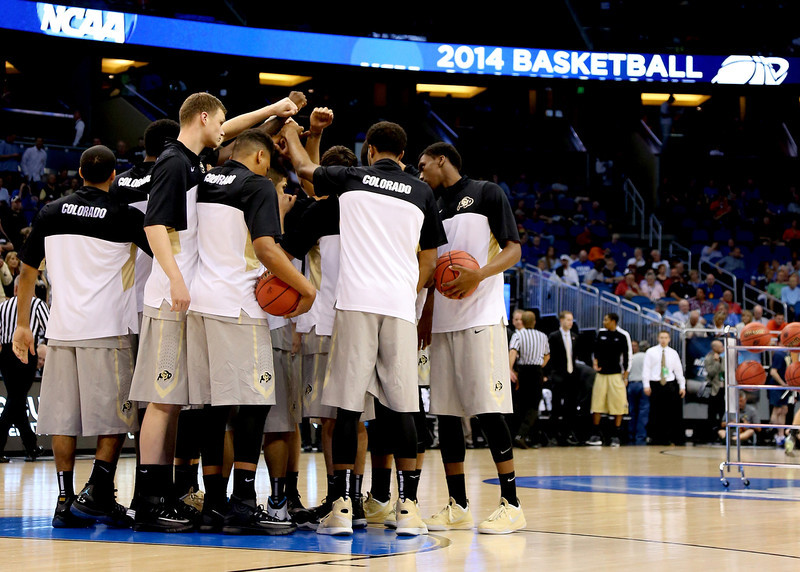 . The Colorado Buffaloes huddle before taking on the Pittsburgh Panthers in the second round of the 2014 NCAA Men\'s Basketball Tournament at Amway Center on March 20, 2014 in Orlando, Florida.  (Photo by Mike Ehrmann/Getty Images)
