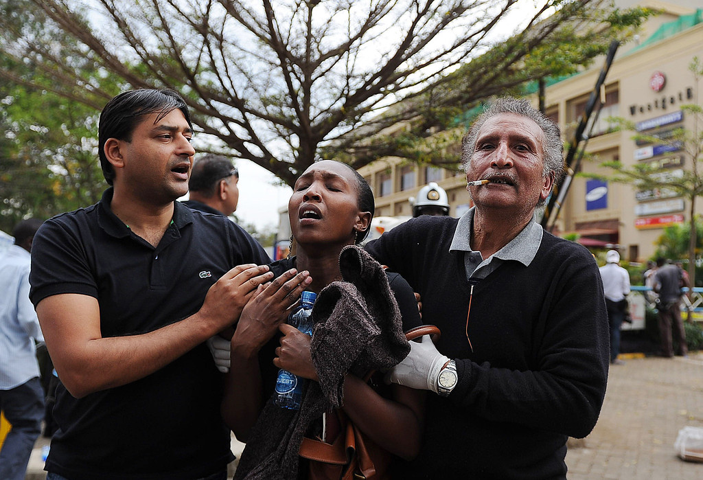 . A woman (C) who had been held hostage reacts in shock on September 21, 2013 after she was freed following a security operation at an upmarket shopping mall in Nairobi where suspected terrorists engaged Kenyan security forces in a drawn out gun fight. Some 20 people have been killed and about 50 wounded Saturday in the initial attack by the gunmen the Kenya Red Cross said.  AFP PHOTO / Tony KARUMBA/AFP/Getty Images