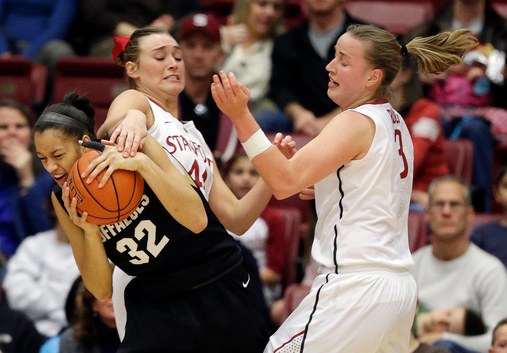 . Colorado \'s Arielle Roberson (32), left, grabs a rebound next to Stanford \'s Joslyn Tinkle (44) and Mikaela Ruef (3) during the first half of an NCAA college basketball game in Stanford, Calif., Sunday, Jan. 27, 2013. (AP Photo/Marcio Jose Sanchez)