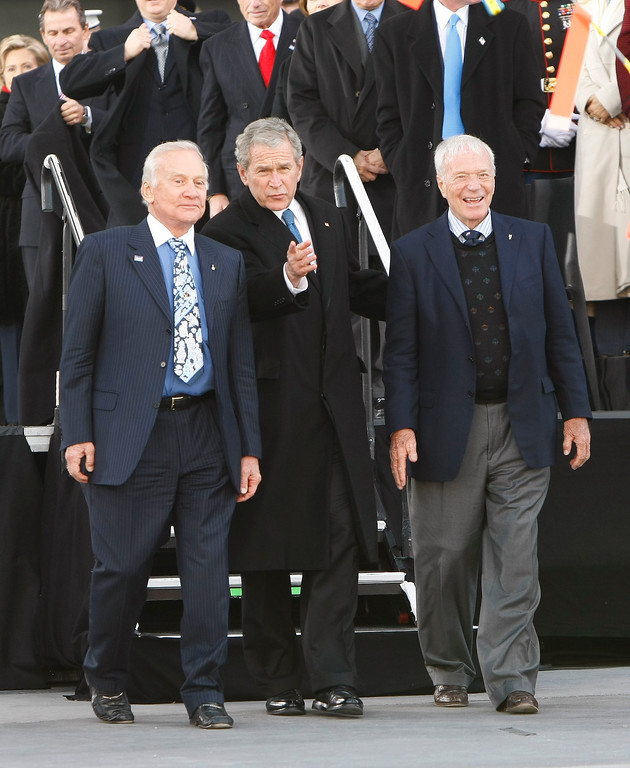 . President Bush walks with former astronauts Edwin \'Buzz\' Aldrin, left, and Scott Carpenter during the rededication ceremony of the Intrepid Sea, Air and Space Museum  in New York, Tuesday, Nov. 11, 2008.  (AP Photo/Gerald Herbert)