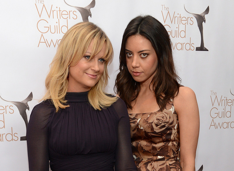 . Actresses Amy Poehler (L) and Aubrey Plaza arrive at the 2013 WGAw Writers Guild Awards at JW Marriott Los Angeles at L.A. LIVE on February 17, 2013 in Los Angeles, California.  (Photo by Jason Kempin/Getty Images for WGAw)