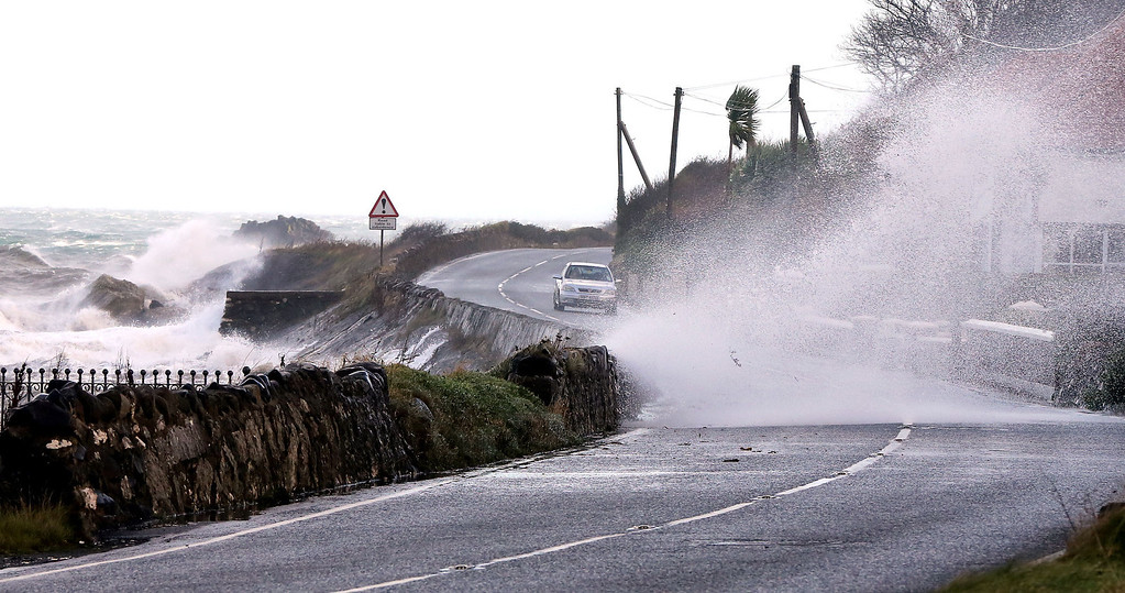 . High winds and the sea batter the Antrim coast road,  in County Antrim, Northern Ireland, Thursday, Dec. 5, 2013.  (AP Photo, PA, Paul Faith)
