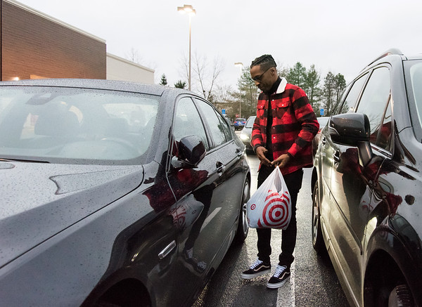 11/26/18 Wesley Bunnell | Staff Sean Milner of West Hartford walks to his car after shopping at Target in New Britain on Monday afternoon.