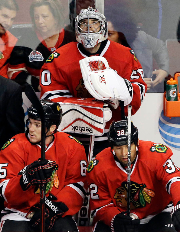 . Chicago Blackhawks goalie Corey Crawford (50) looks up a score board during the third period. (AP Photo/Nam Y. Huh)