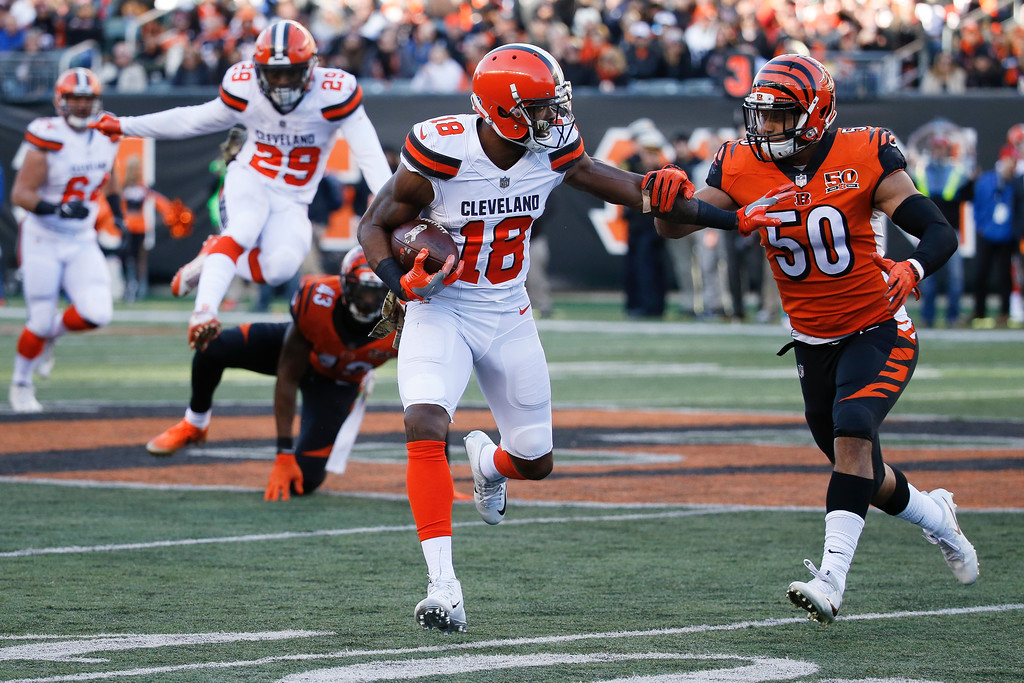 . Cleveland Browns wide receiver Kenny Britt (18) runs the ball against Cincinnati Bengals linebacker Jordan Evans (50) in the second half of an NFL football game, Sunday, Nov. 26, 2017, in Cincinnati. (AP Photo/Frank Victores)