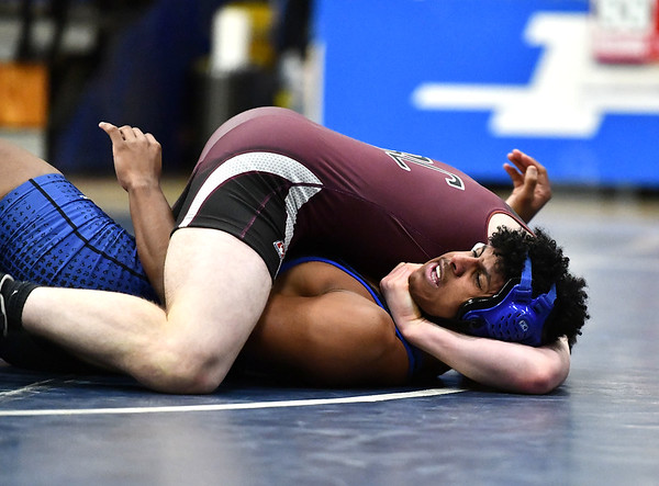 1/8/2020 Mike Orazzi | StaffrBristol Central's Matt Duquette and Plainville's Felix La Oz during Wednesday night's match.