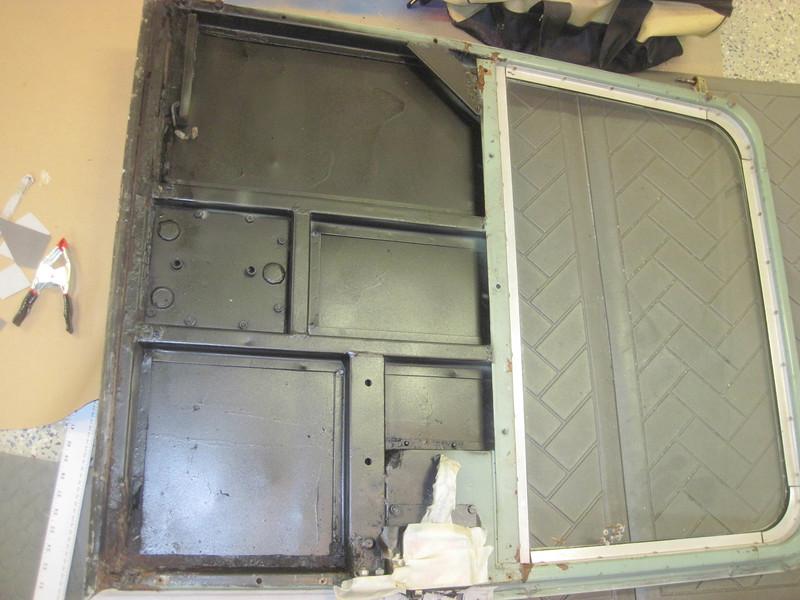 Repainted inside rear door with rubber coating.