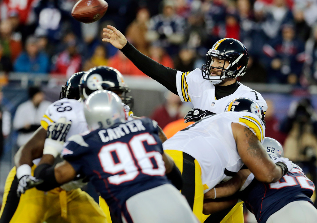 . Pittsburgh Steelers quarterback Ben Roethlisberger (7) passes over New England Patriots defensive end Andre Carter (96) in the first quarter of an NFL football game Sunday, Nov. 3, 2013, in Foxborough, Mass. (AP Photo/Charles Krupa)