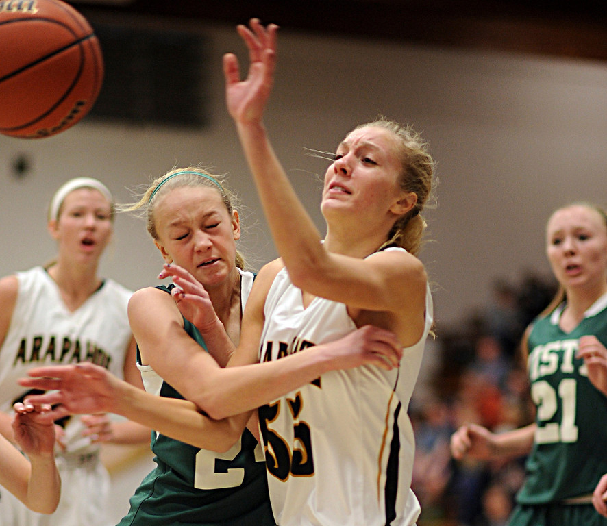. Mountain Vista\'s Kirsten Burr, left, and Arapahoe\'s Molly Reidel collide in the first half of the game at Arapahoe High School Gym on Saturday, Jan. 5, 2013, in Centennial, Colo. Arapahoe won 74-38. Hyoung Chang, The Denver Post