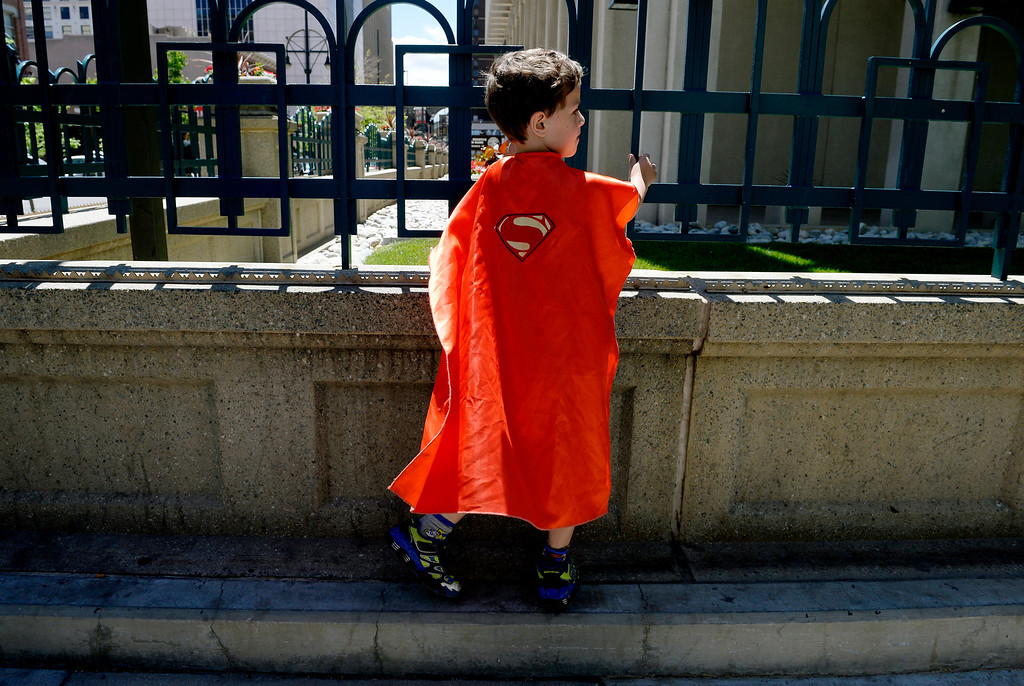 . DENVER, CO. - JUNE 01: Abdullah Sharif, 7, entertains himself on the 16th Street Mall after visiting the Denver Comic Con at the Colorado Convention Center Denver, CO June 01, 2013. The Sunday forecast calls for mostly sunny skies with highs in the upper 70s. (Photo By Craig F. Walker/The Denver Post)