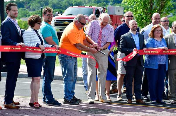 6/7/2019 Mike Orazzi | Staff Schultz Corporation's Thomas Bryda and Howard Schmelder cut the ribbon during the opening of Hope Street in downtown Bristol Friday morning.
