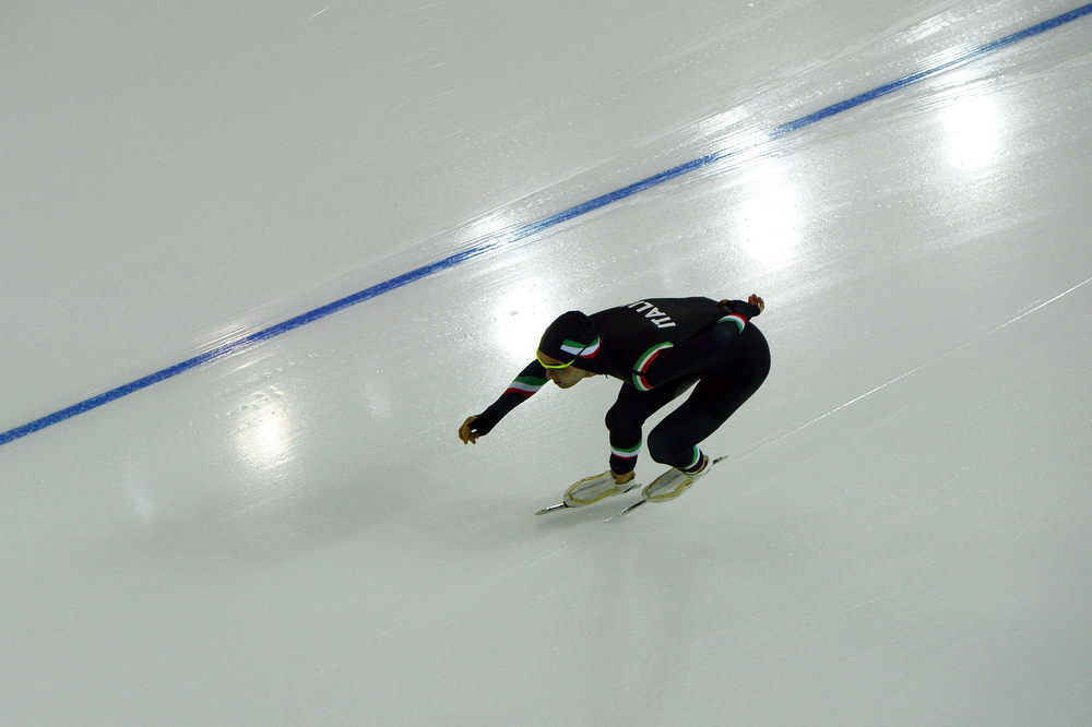 . A picture taken with a robotic camera shows Italy\'s Andrea Giovannini competing in the Men\'s Speed Skating 5000m at the Adler Arena during the 2014 Sochi Winter Olympics on February 8, 2014.  (ANTONIN THUILLIER/AFP/Getty Images)