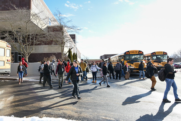 020117 Wesley Bunnell   Staff  Students exit New Britain High School at the end of school day on Wednesday and prepare to board buses for their ride home.