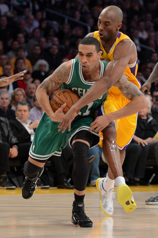 . Lakers Kobe Bryant defends against Celtics\' Courtney Lee during their game at Staples Wednesday.  Photo by David Crane/Staff Photographer