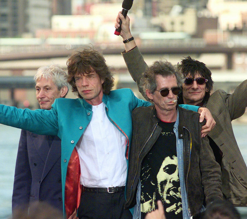 """. The Rolling Stones announce their \""""Bridges to Babylon\"""" tour beneath the Brooklyn Bridge in the Brooklyn borough of New York Monday, August 18, 1997. From left are: Charlie Watts, Mick Jagger, Keith Richards and Ron Wood.  (AP Photo/Mark Lennihan)"""