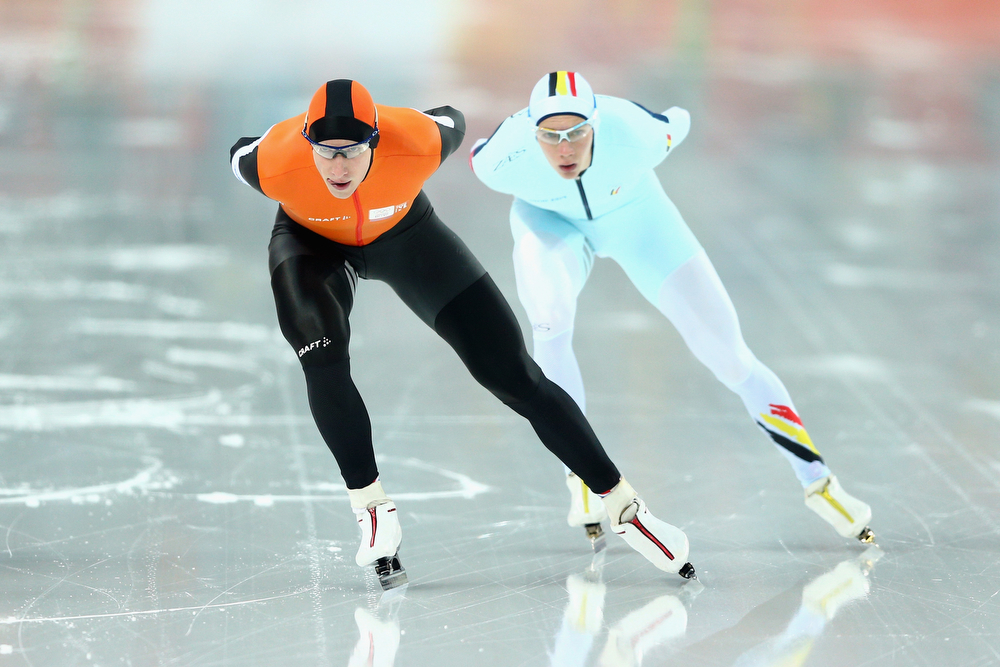 . Jan Blokhuijsen (L) of the Netherlands and Bart Swings of Belgium compete during the Men\'s 5000m Speed Skating event during day 1 of the Sochi 2014 Winter Olympics at Adler Arena Skating Center on February 8, 2014 in Sochi, Russia.  (Photo by Paul Gilham/Getty Images)